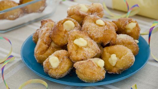 Frittelle ripiene alla crema ricetta di pronto in tavola - Ricette monica bianchessi pronto in tavola ...