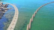 """Sardegna, una barriera di lana """"mangia"""" il petrolio in mare"""